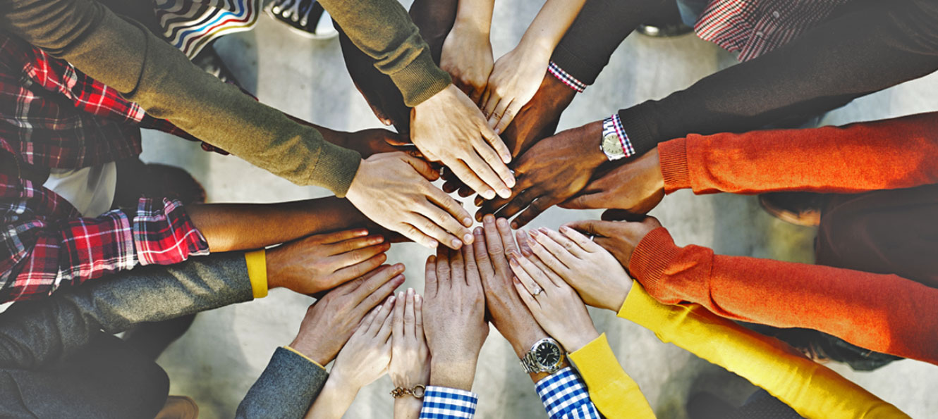 closeup of a group of hands gathered together in a circle