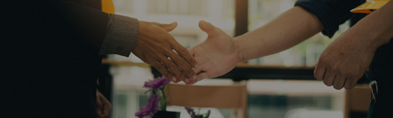 closeup of two hands shaking in a business partnership